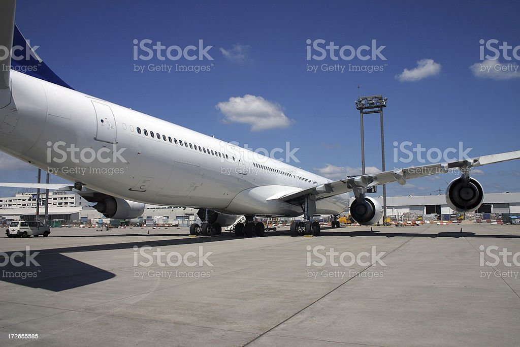Airplane at the gate from behind royalty-free stock photo