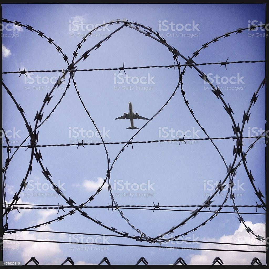 airplane behind fence stock photo