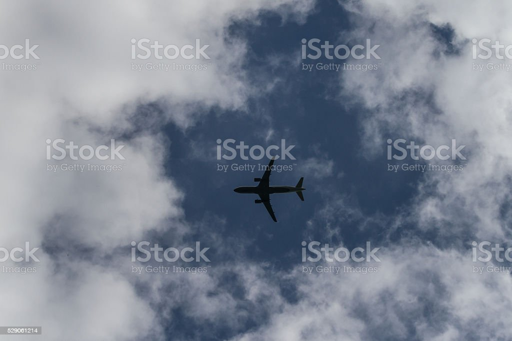 Airplane between the clouds stock photo