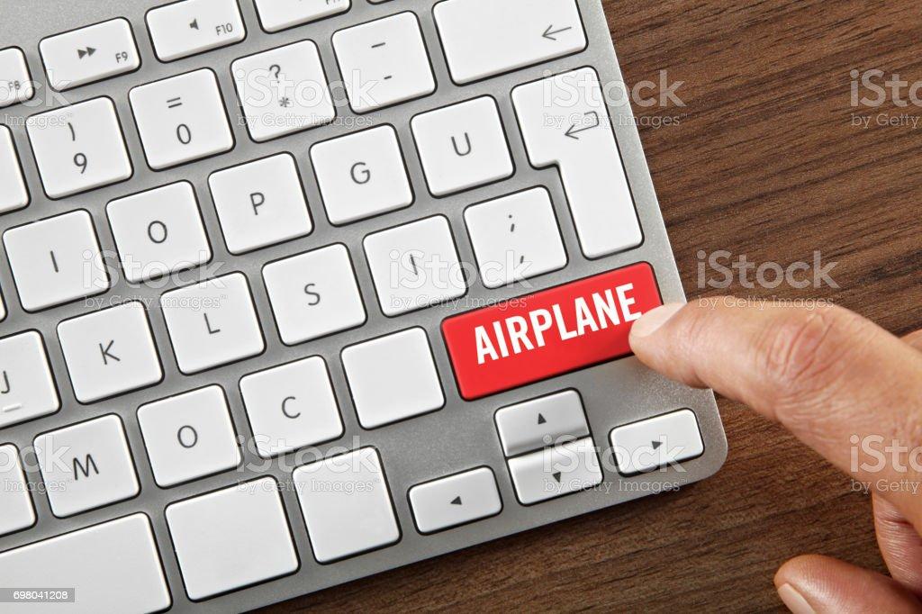 Airplane button stock photo