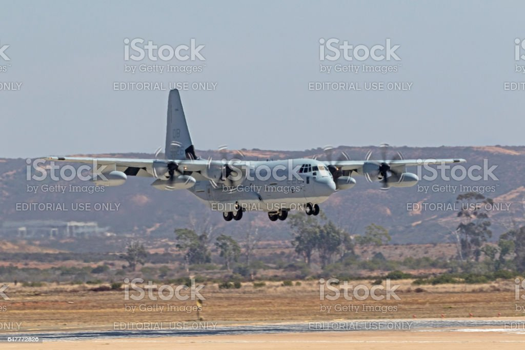Airplane C-130 troop transport aircraft landing at air show stock photo