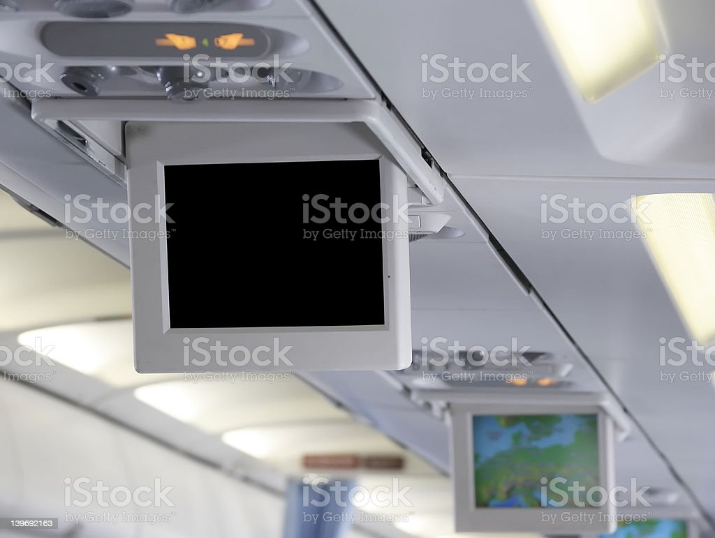 Airplane cabin interior with a blank video screen royalty-free stock photo
