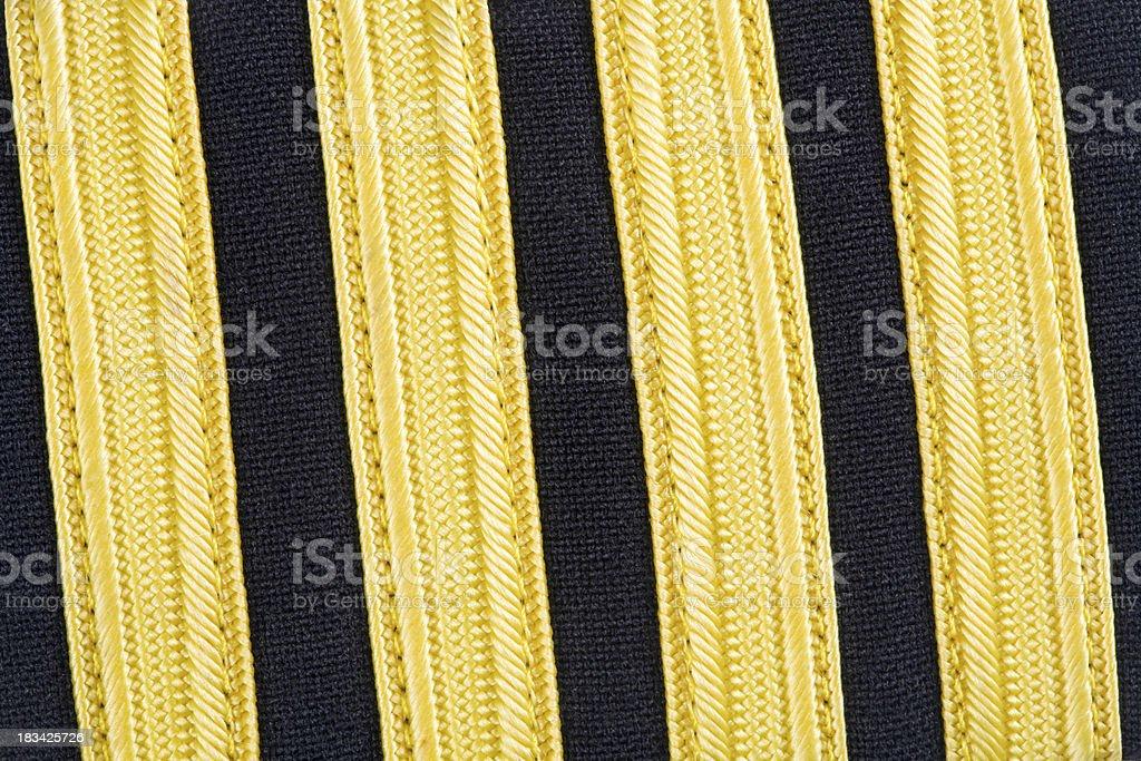 Airplane Captain's Four-Bar Black/Gold Shoulder Epaulette Background stock photo