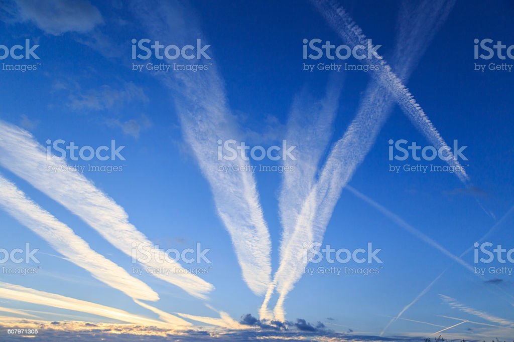 Airplane chemtrails in sky above Nottinghamshire, England. stock photo