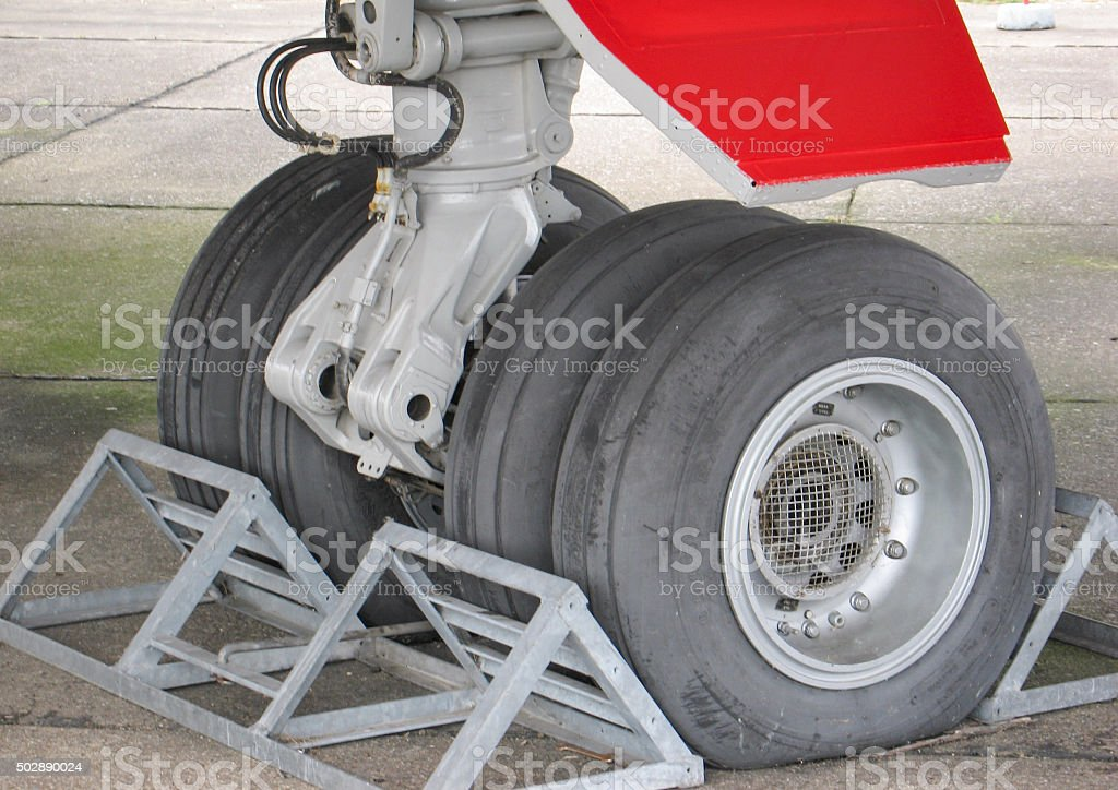 Airplane Chocks and undercarriage section stock photo