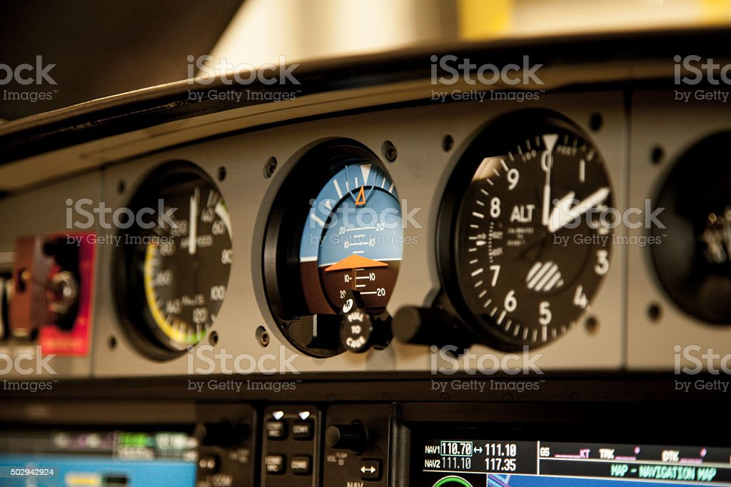 Airplane Cockpit Flight Instrument - Attitude Indicator stock photo