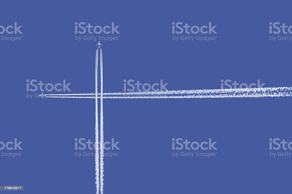 Airplane contrails crossing stock photo