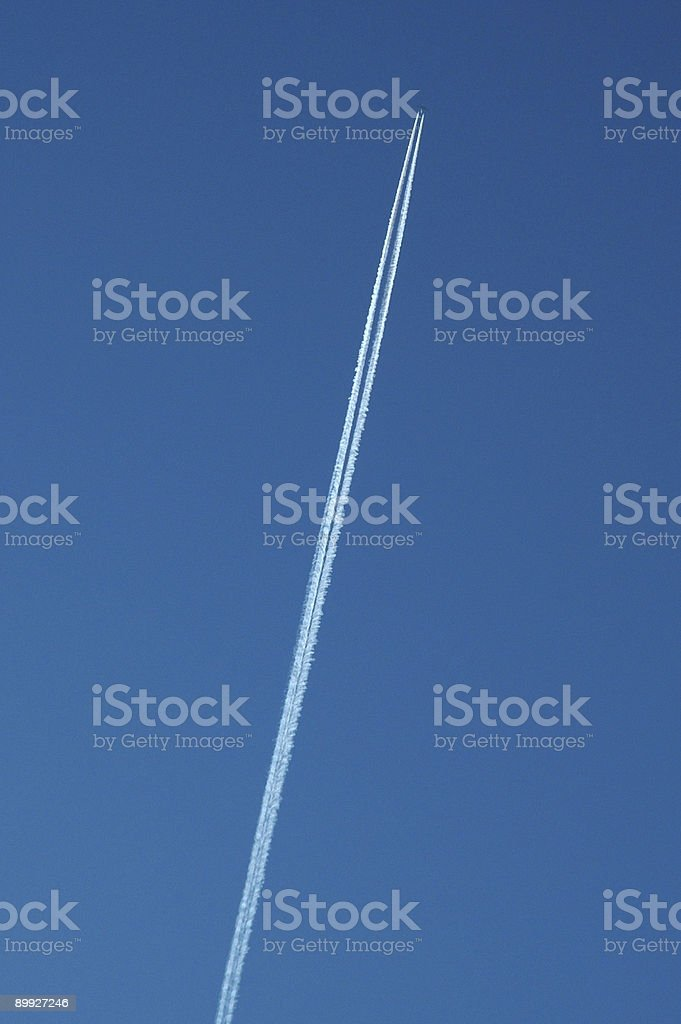 Airplane creating a Vapor Trail royalty-free stock photo