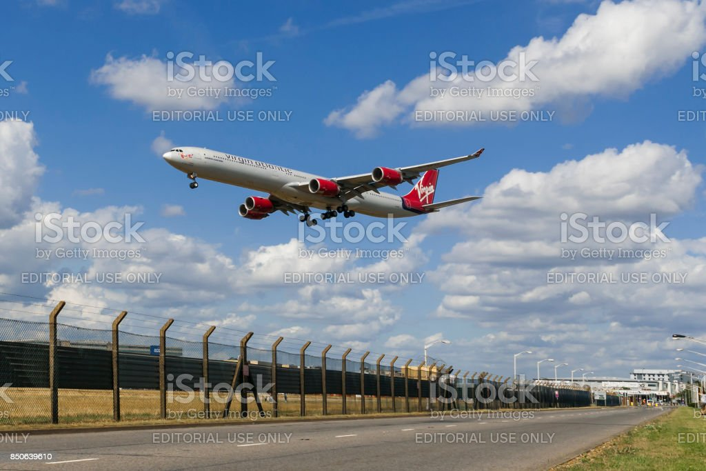 Airplane cross road in London stock photo