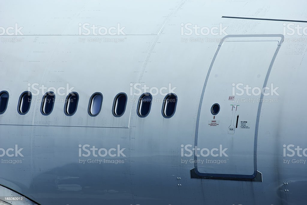 ... airplane detail with windows and exit door stock photo ... & Airplane Door Pictures Images and Stock Photos - iStock Pezcame.Com