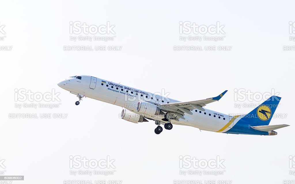 Airplane Embraer in the sky stock photo