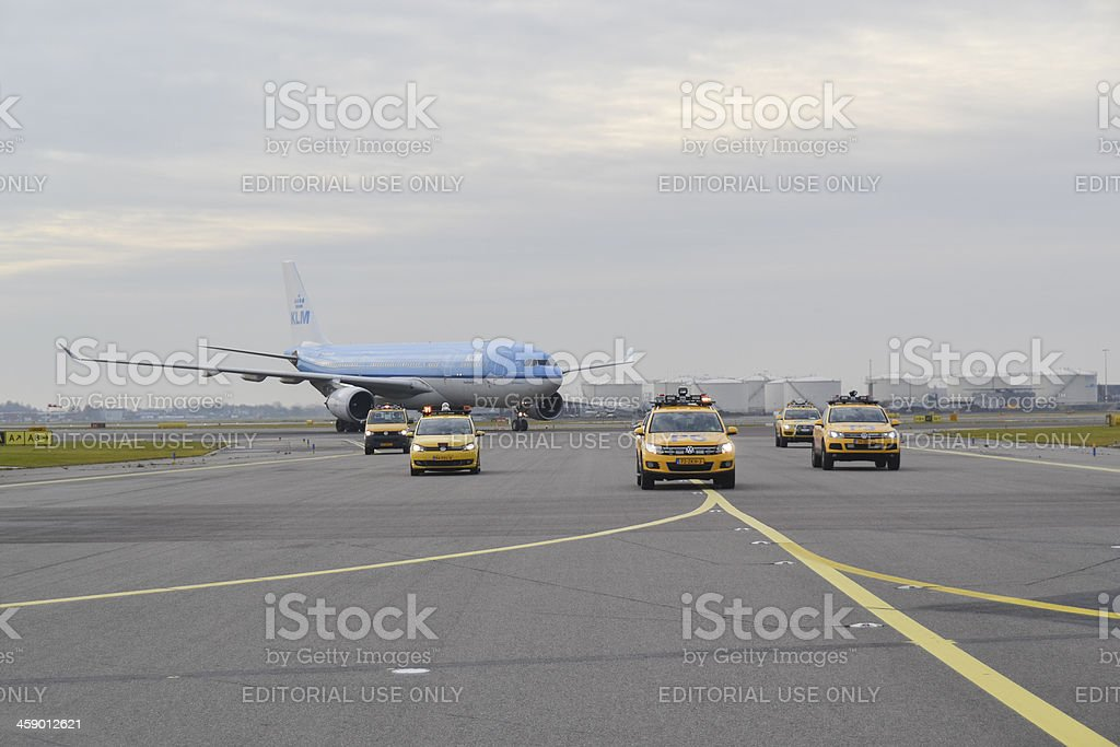 airplane escorted by airport authorities royalty-free stock photo