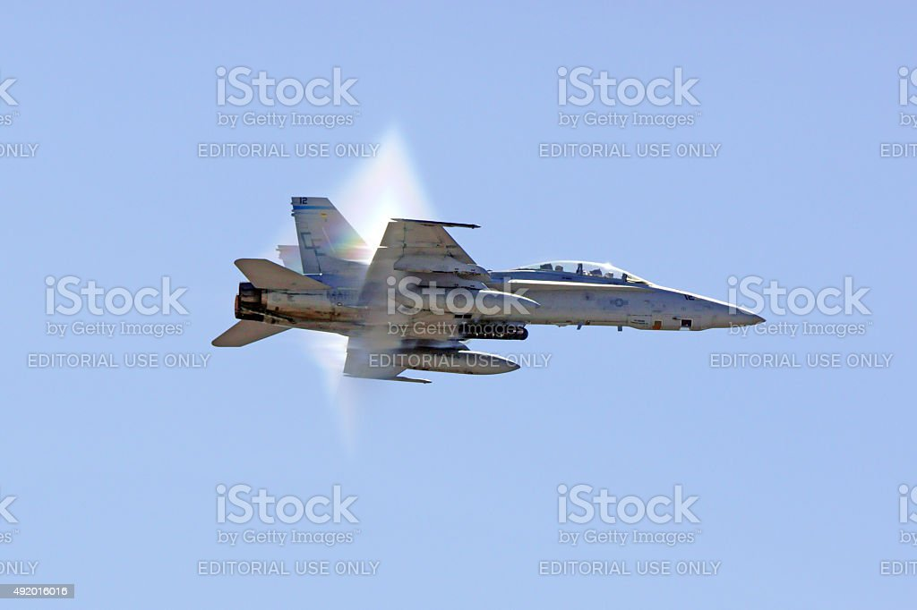Airplane F-18 Hornet Jet breaking sound barrier stock photo