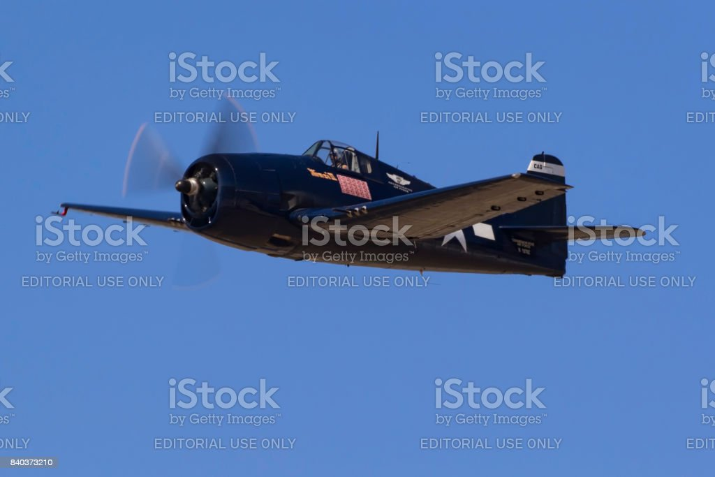 Airplane F6F Hellcat WWII aircraft flying at airshow stock photo