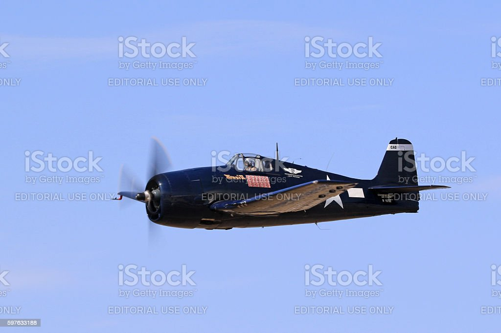 Airplane F6F Hellcat WWII aircraft flying stock photo