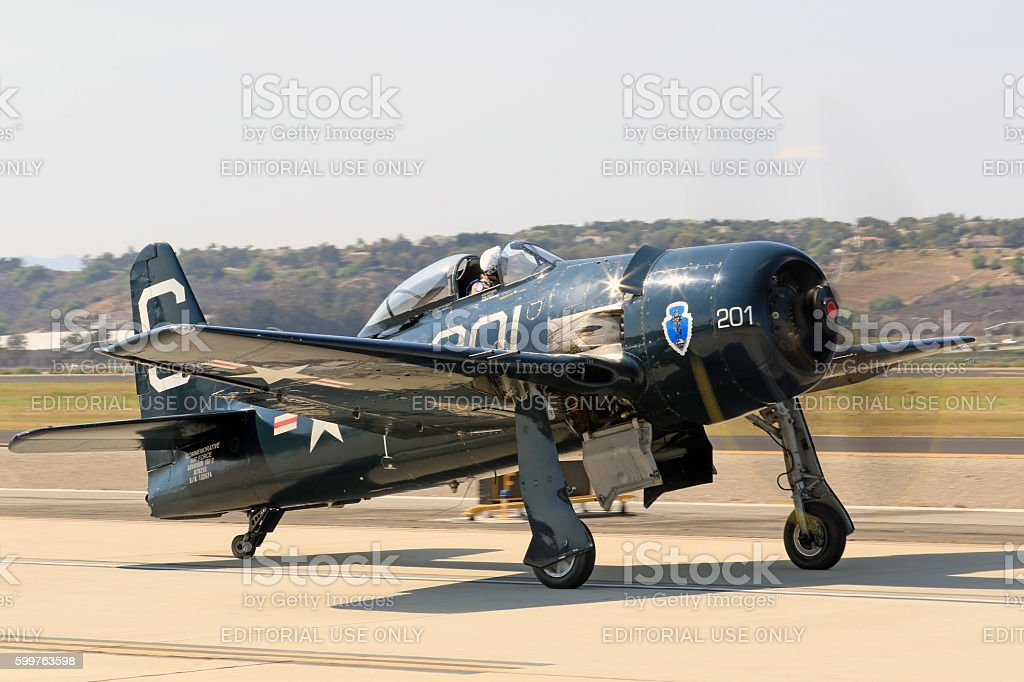 Airplane F8 Bearcat fighter on runway stock photo