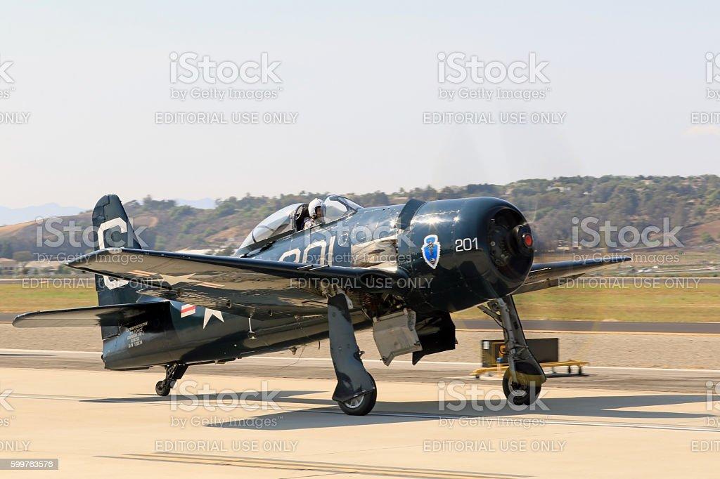 Airplane F8 Bearcat on runway at air show stock photo