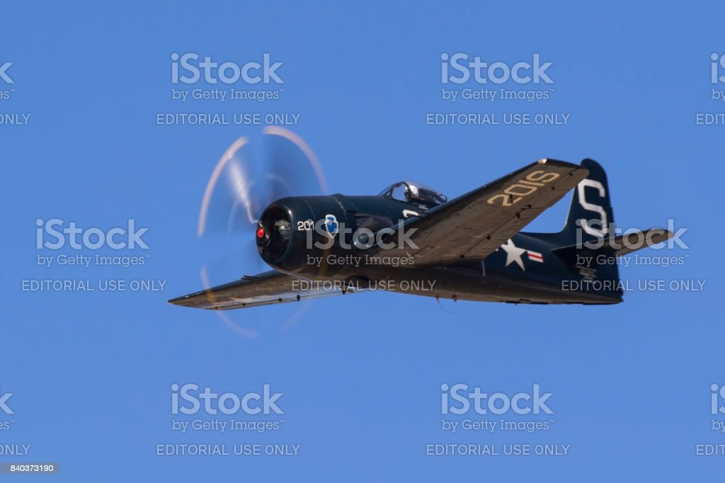Airplane F8F Bearcat WWII vintage fighter flying at airshow stock photo