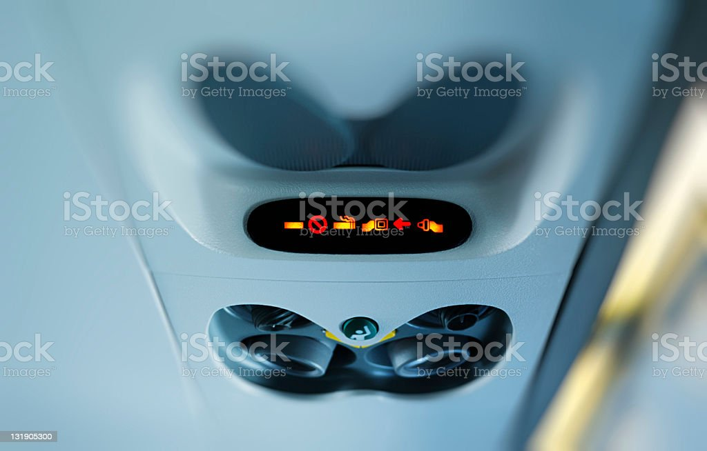 Airplane fasten seatbelt sign stock photo