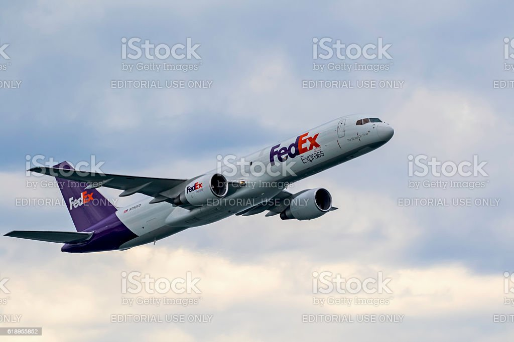 Airplane FedEx jet flying at air show stock photo