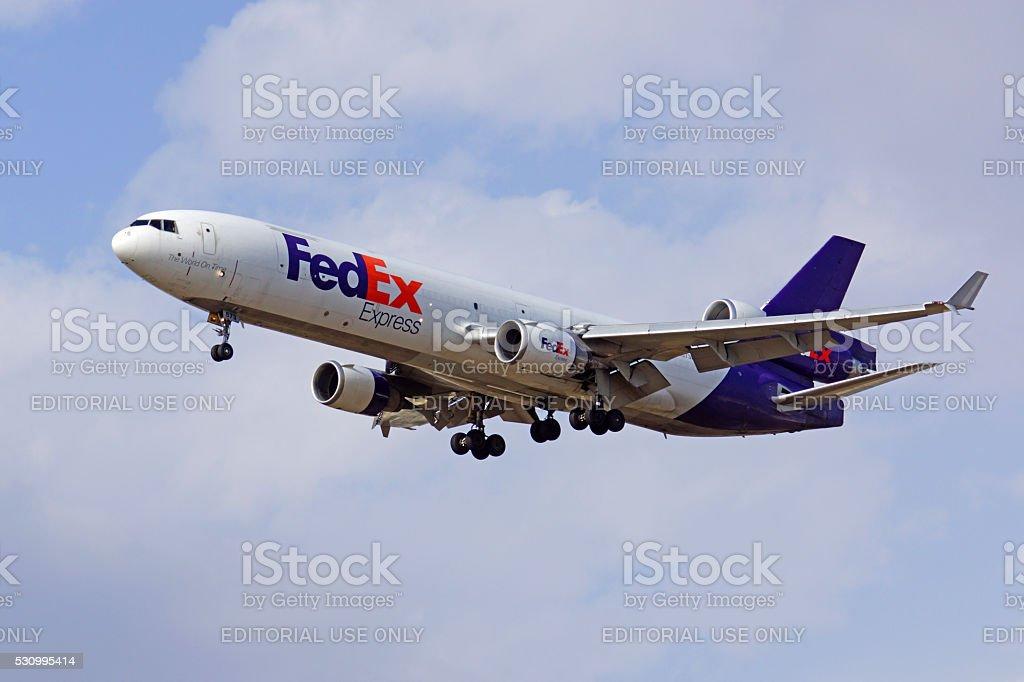 Airplane FedEx MD-11 freight jet stock photo