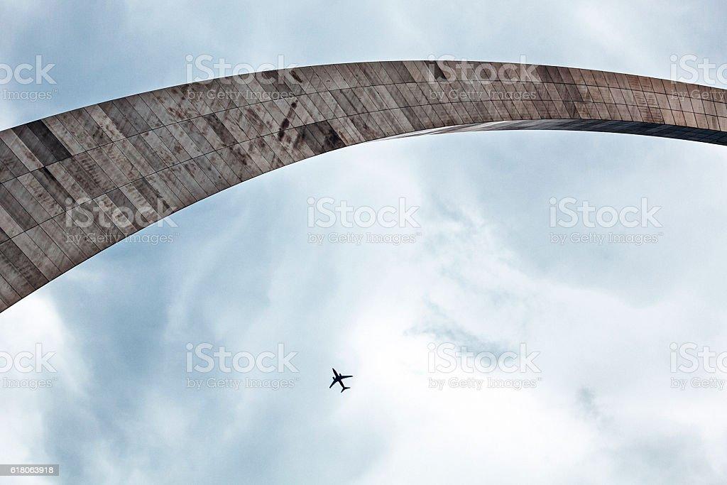 Airplane flies above Gateway Arch. St Louis, Missouri. stock photo