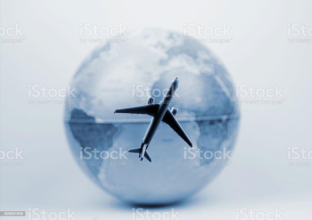 Airplane  flies around the  world stock photo