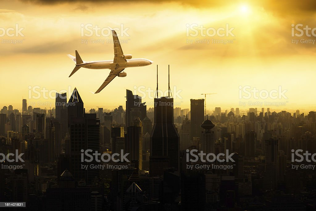 airplane fly above city royalty-free stock photo