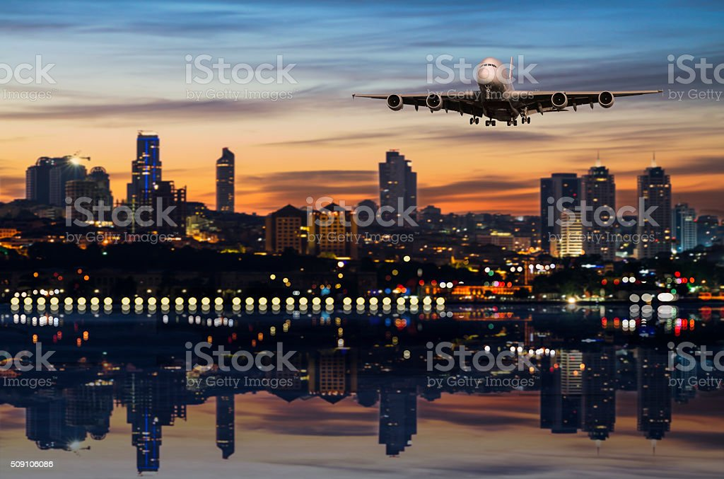 Airplane fly above the city stock photo