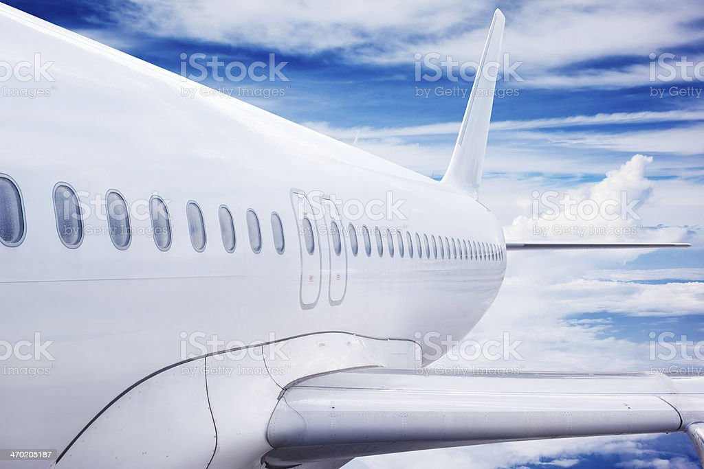Airplane Flying Above Cloud stock photo