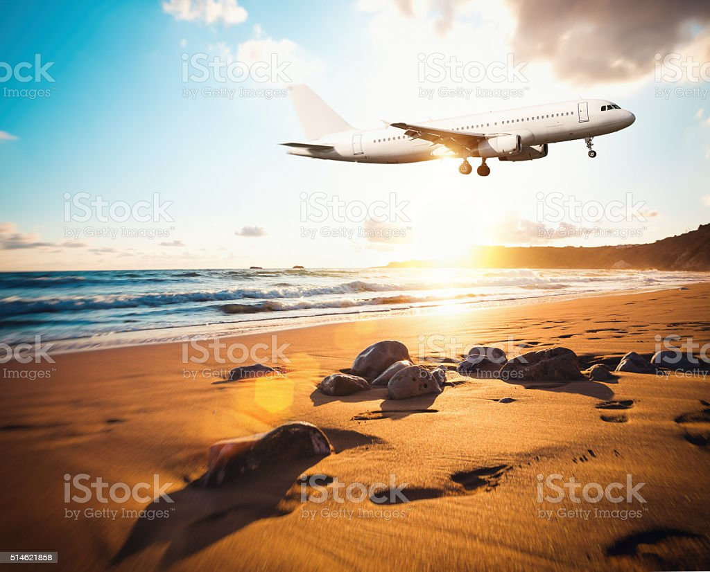Airplane Flying Above The Beach stock photo