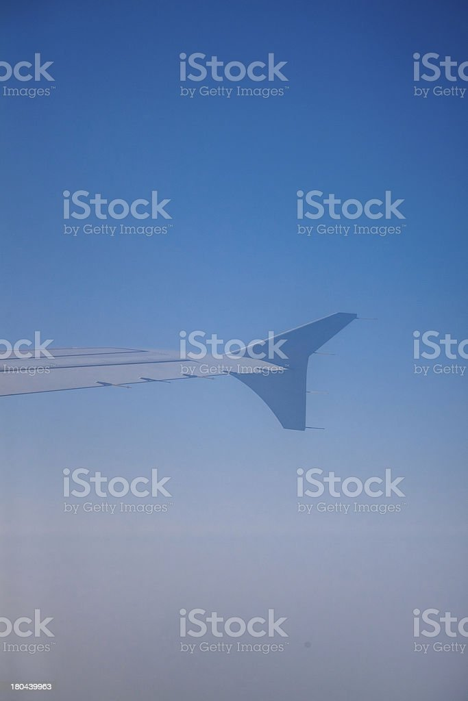 Airplane Flying above the Earth royalty-free stock photo