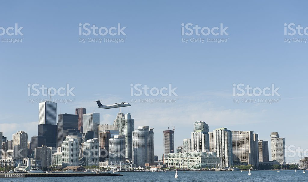 airplane flying above the skyline of downtown toronto royalty-free stock photo