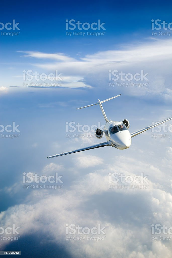 Airplane flying around a Storm Front stock photo