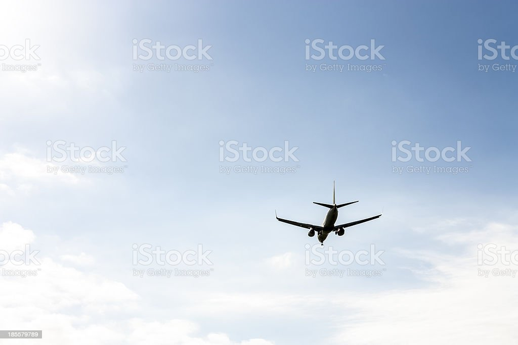 airplane flying at blue sky royalty-free stock photo