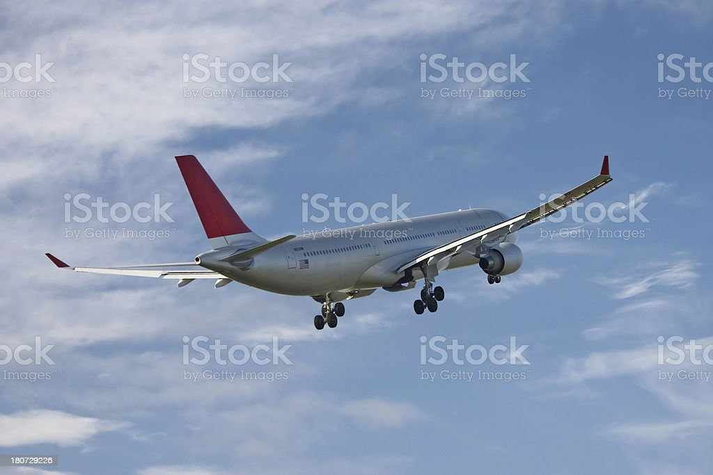 airplane flying away royalty-free stock photo