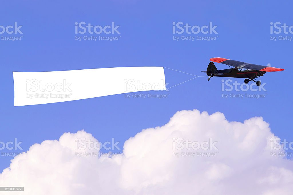 Airplane flying blank banner stock photo