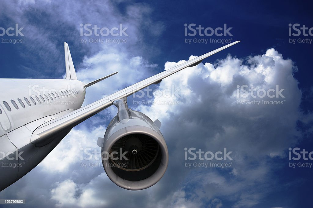 airplane flying down royalty-free stock photo