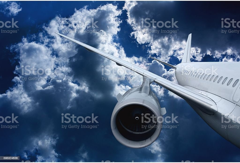 airplane flying down stock photo