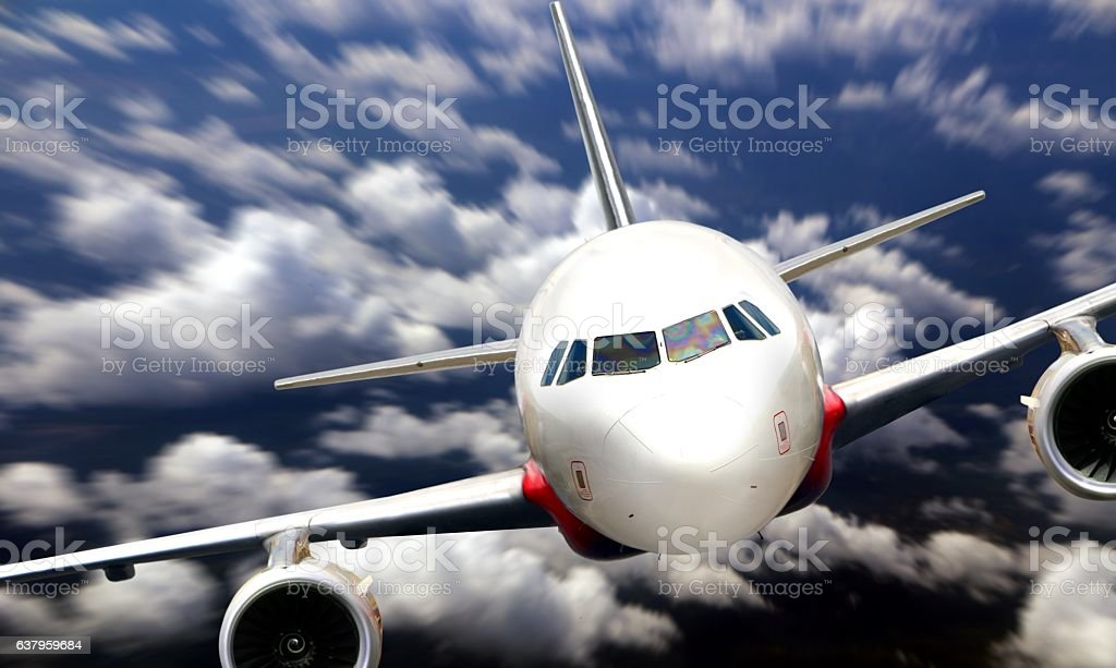 Airplane flying from nose view stock photo