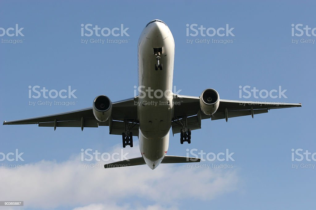 Airplane flying, frontview stock photo