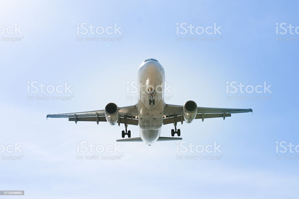 Airplane flying in sky stock photo