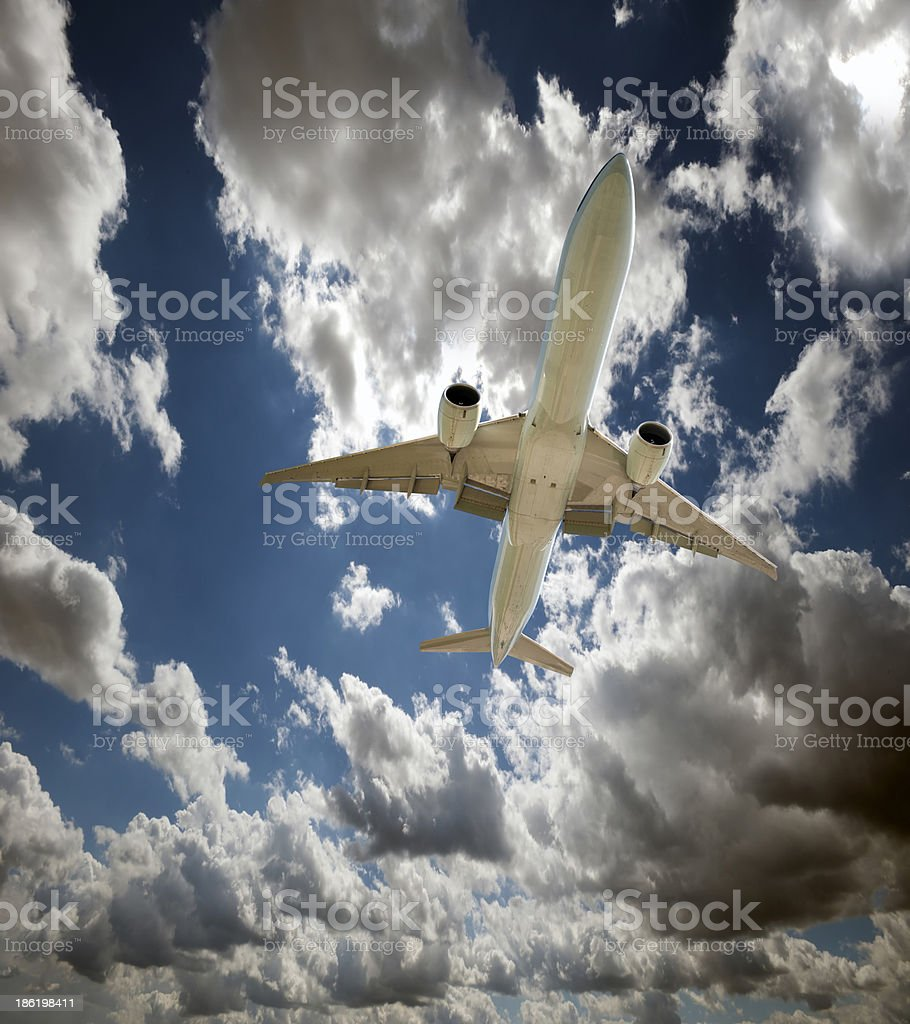 Airplane flying in the sky stock photo