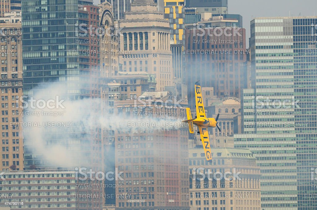 Airplane flying low in New York City. stock photo