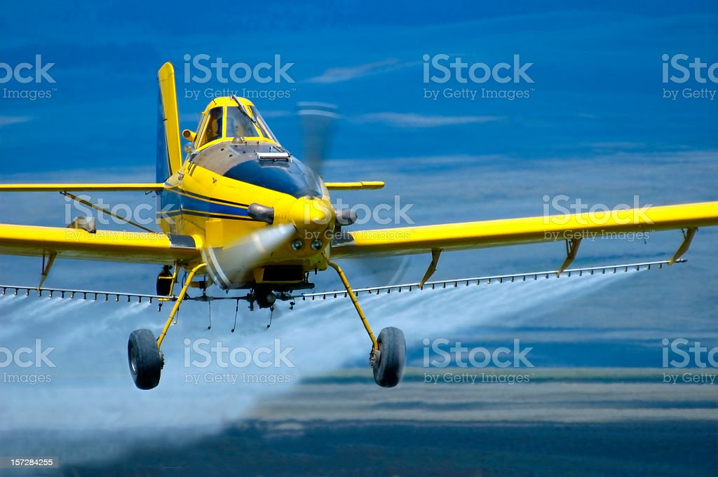 Airplane flying low on the water stock photo