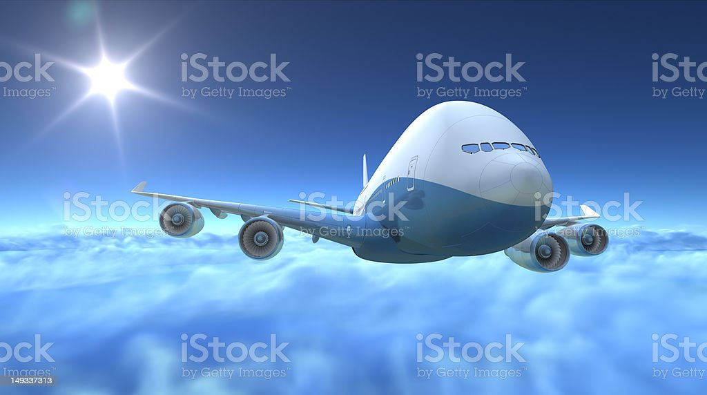 Airplane flying over clouds stock photo