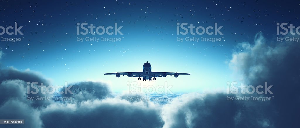 Airplane flying over cloudy sky. stock photo