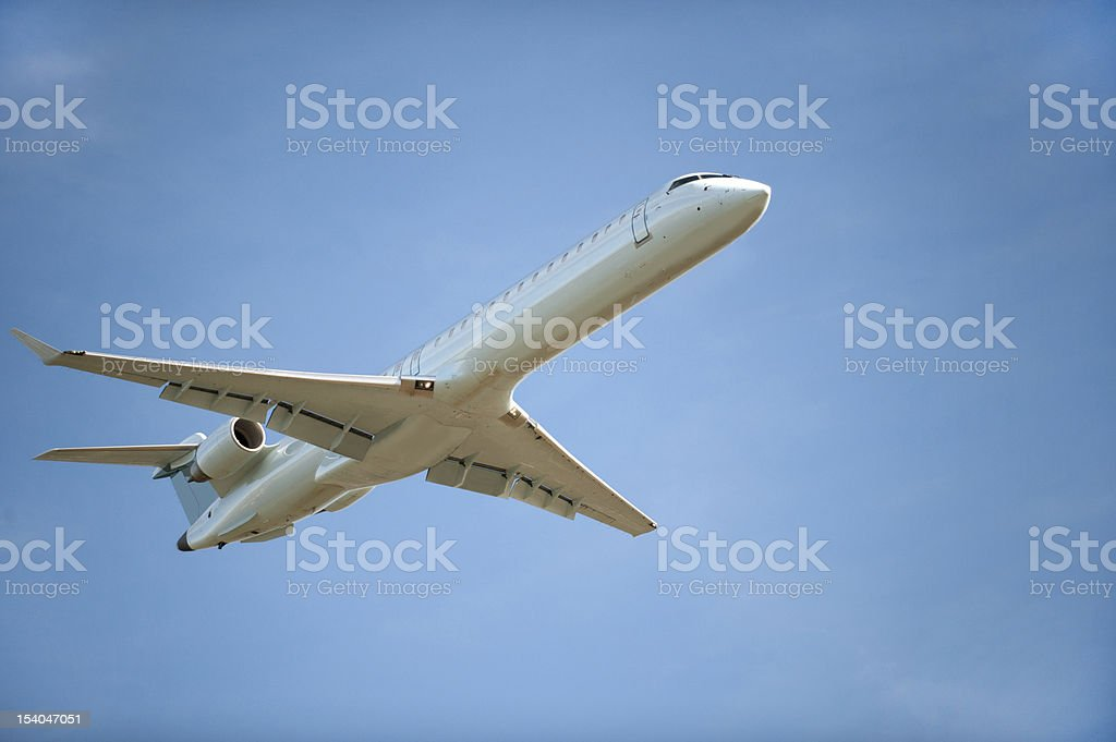 Airplane flying stock photo