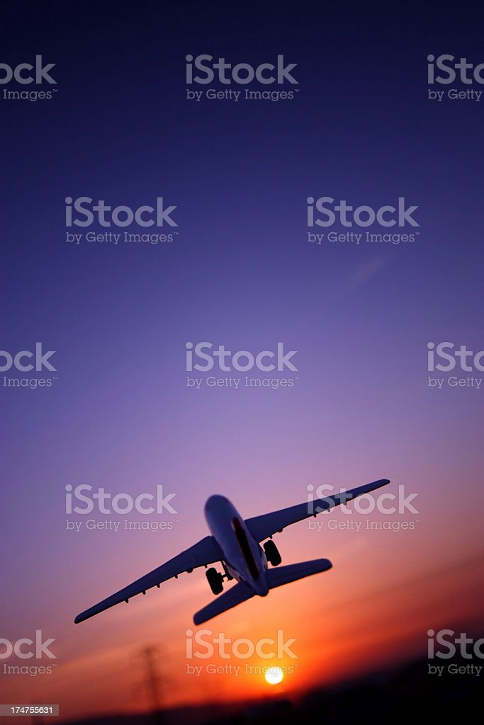 Airplane Flying Up Against The Sunset royalty-free stock photo