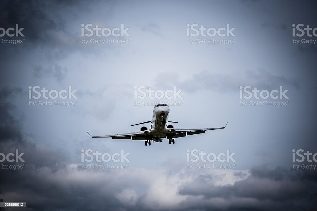 Airplane flying with clouds in background stock photo